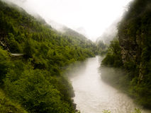 Foggy river. Foggy rainy day. Georgia - Caucasus Swanetia region Royalty Free Stock Photo