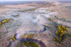 Foggy river aerial view. Drone view on mist river nature landscape. Riverside from above. Scenic river. Foggy river aerial view. Drone view on mist river nature royalty free stock image