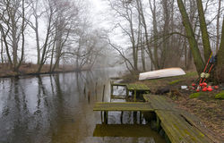 Foggy river with fisherman equipment Royalty Free Stock Photography