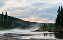 Foggy river after a heavy thunderstorm Royalty Free Stock Photo