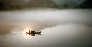 Foggy River In Sunrise Stock Photos