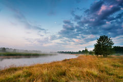 Foggy river in the morning. Summer foggy sunrise. Misty morning Stock Images