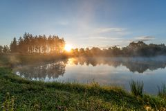 Foggy river in the morning. Summer misty sunrise on the river stock photos