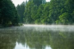 Foggy river in the morning. Summer misty sunrise on the river stock photography