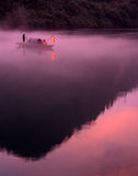 Foggy river in sunrise. Picture is of a Foggy morning along Lost River,two fishe-rmen in small craft Stock Photography