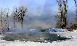 Foggy river in winter. Picture taken by a very cold day in Quebec, Canada royalty free stock images