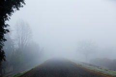 Foggy Road. A Foggy Road on a Damp Winter Morning Stock Photos