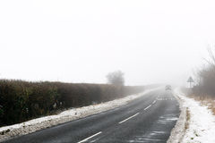 Foggy road Stock Image