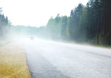 THE FOGGY ROAD WITH CAR Stock Photos