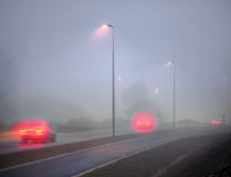 Foggy road in evening Royalty Free Stock Image