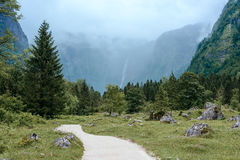 Foggy road leads to the waterfall. Royalty Free Stock Photos
