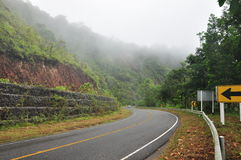 The Foggy road in the morning time. At south of Thailand Royalty Free Stock Photo