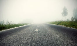 Foggy road, soft focus Stock Images