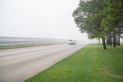 Foggy road traffic Stock Image