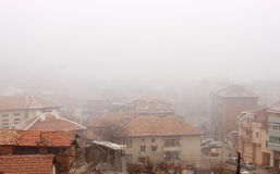 Foggy Roofs. View of a small town red roofs in fog. Photo taken in Blagoevgrad, Bulgaria Stock Images