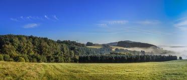 Foggy rural landscape in morning in the eifel Stock Photos