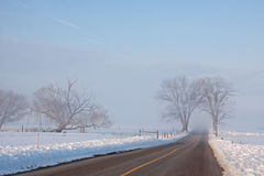 Foggy Rural Road Royalty Free Stock Photos