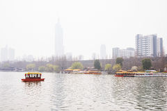 Foggy scene of a boat in the lake Stock Images
