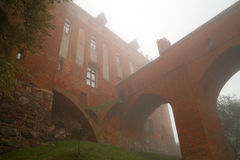 Foggy scenery of Kwidzyn castle Stock Image