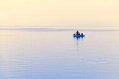 Foggy sea with fisher Royalty Free Stock Photography