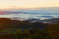 A foggy September morning in the vicinity of the city of San Gimignano. Tuscany, Italy Royalty Free Stock Photo