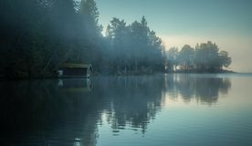 Foggy shores of the lake. Jonsvatnet near Trondheim, Norway. Autumnal morning mood royalty free stock photo