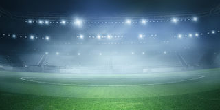 Foggy soccer field . Mixed media Royalty Free Stock Images