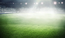 Foggy soccer field . Mixed media Royalty Free Stock Image