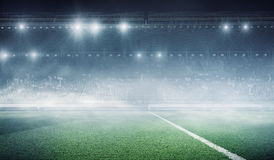 Foggy soccer field . Mixed media Royalty Free Stock Photo