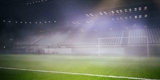 Foggy soccer field . Mixed media Stock Photos