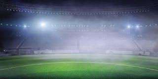 Foggy soccer field . Mixed media Stock Photography
