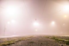 Foggy street lights misty Stock Photography