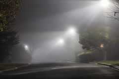 Foggy Street at Night Stock Photo