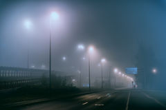 Foggy street with nobody in the suburb Stock Photo