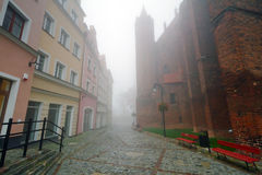 Foggy street scenery of Kwidzyn. Foggy scenery of Kwidzyn castle and cathedral, Poland Stock Image