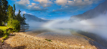Foggy summer morning on the Bohinj lake in Triglav national park Royalty Free Stock Photography