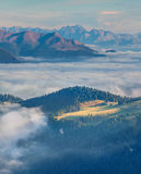 Foggy summer morning in the Val Gardena valley. Royalty Free Stock Images