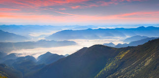 Foggy summer panorama of the mountains. Royalty Free Stock Images