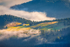 Foggy summer sunrise in the Italian Alps. Royalty Free Stock Photo