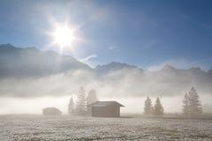 Foggy sunny morning pver winter alpine meadows Royalty Free Stock Photos