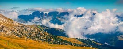 Foggy sunny panorama of the Val Gardena valley stock photography