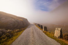 Foggy and sunny road in Norway Gamle Strynefjellsvegen Stock Photos