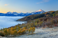 Foggy sunrise with morning light in the Wasatch Mountains. Stock Images