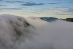 Foggy sunrise in mount Cucco National Park, Umbria, Italy Stock Image