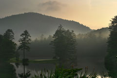Foggy Sunrise on Mountain Lake Stock Photos