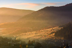 Foggy sunrise in mountainous countryside Stock Images