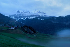 Foggy sunrise over Dolomites mountains Royalty Free Stock Photo