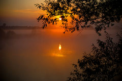 Foggy sunrise over the lake. Foggy sunrise over the mistic lake stock photo