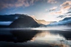 Foggy sunrise over the mountains Stock Image
