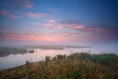 Foggy sunrise over river Royalty Free Stock Photography